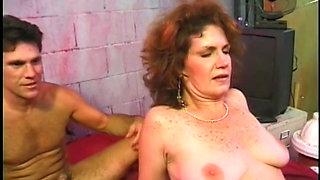 Mature Angela Cee sucks and fucks two cocks