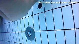 Naked men and women in the pool filmed underwater