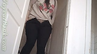 Chunky white brunette lady texting and pissing in the toilet