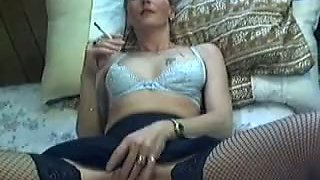 This wicked MILF in sexy skirt loves to smoke and she masturbates a lot