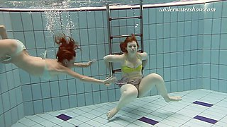 Sexy redhead  gal Ala and her GF swim naked in the pool