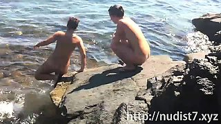 Nudist female with big clit nude on beach voyeur cam