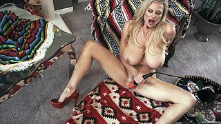 Kelly spreading legs while masturbating using toy