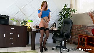 This babe is one sexy office slut you'd love to fuck and she loves her pussy