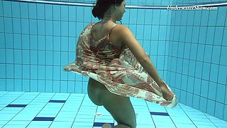 Russian brunette teen shading attire in the pool lovely