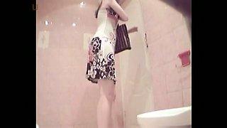 Hidden camera in women's toilet captures hot chicks exposing pussies