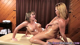 Oiled masseuse scissoring