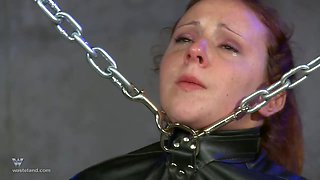 Redhead slave strapped in a straight jacket and pussy abused hardcore