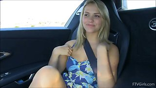 Fantastic blonde teen pinching her nipples in the car