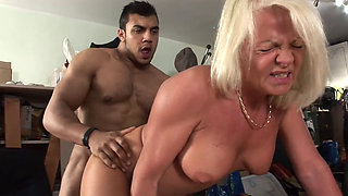 Mature blonde fucked by a large cock