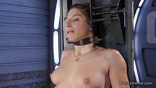 Brunette in bondage fucking machine