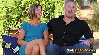 Swingers sit by the pool to foreplay for a while before the party