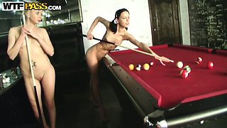 Lewd nude girls play pool in the presence of their friends