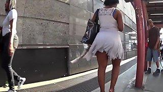 Smoking hot ebony lady with big booty walks around in a short dress