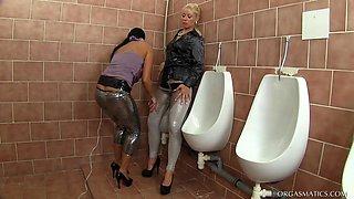 Slutty Cheaters In Orgasmic Wrath with a vibrator in a washroom.