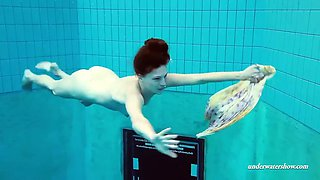 excuisite euro girl lera swimming and undressing underwater