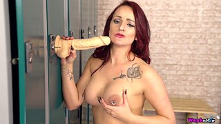 Naughty chick Georgie Newman is playing with suction cup dildo in the locker room
