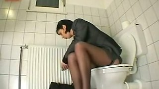 Hidden cam in the office toilet catches sexy milf lady