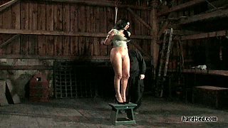Sexy brunette is punished in the dark cold room
