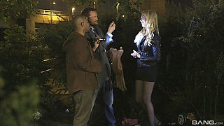 Cute blonde is at the center of a gangbang in the darkness
