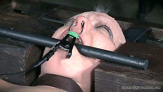 BDSM slave is forced to bite metal bar and gets her nipples clamped
