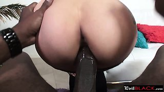 Dark haired slut giving head to black monster cock
