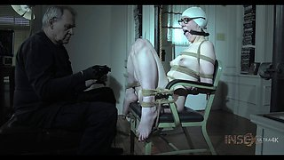 Blonde in vintage lingerie rope bound and abused