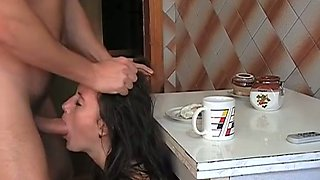 Submissive Russian brunette Vika sucks fat cock in kitchen