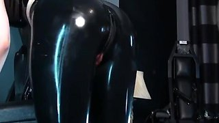 Masked slut in black latex rubber sucks and fucks for facial