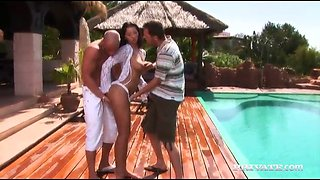 hot brunette gets banged by two dudes by pool