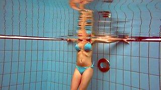 Underwater striptease by sex-appeal swimmer Deniska