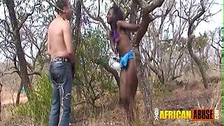 Interracial African BDSM couple outdoor