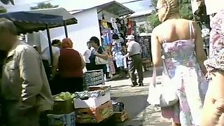 Long dress upskirt in street market