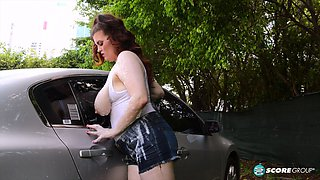 Chunkier big titty red head washes car with tits and clit