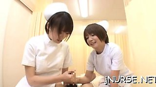 Breathtaking japanese nurse plays with toys on a large rod