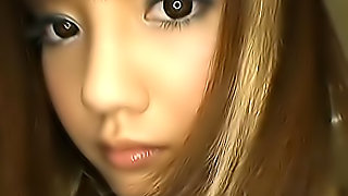 Lovely Asian school girl is doing a little cock sucking