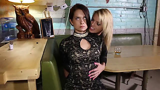 Sexy brunette held captive by a hot blonde