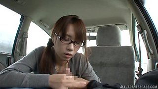 Nerdy brunette babe finally gets to suck a big cock in the car