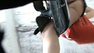 Pale skin booty of a stranger girl filmed from underneath in the toilet