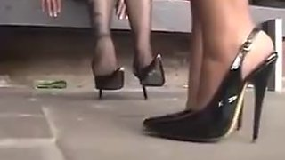 Sexy girl and a  hot MILF dangle their feet in pantyhose