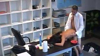 Hidden cam finds slutty secretary fucking her boss in the office