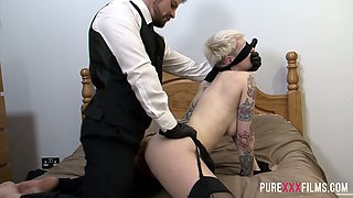 Clothed dude fucks tattooed blond whore tied up to a bed