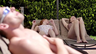 Pool front fun with red head and brunette