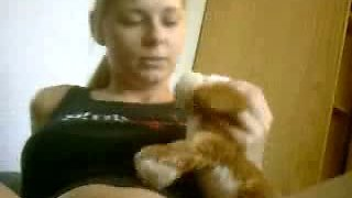 Lovely blonde cutie pleasing herself with stuffed toy