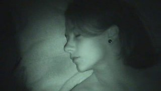 Jerking off onto her little tits in a POV night vision video