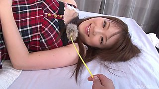 Hairy pussy of a Japanese cutie Nazuna Otoi exposed on the bed