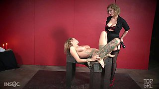 Busty tattooed girl bound tight by rope as mistress plays with her