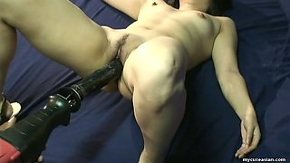Asian wild slut is fucked hardcore with a heavy duty fuck machine