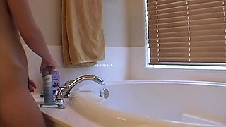 Teen amateur blonde solo in the shower