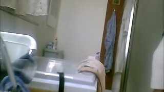 Hairy wife spied in bathroom after shower